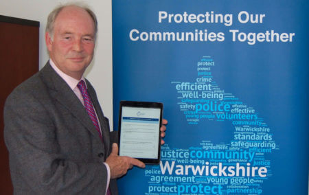 Warwickshire PCC Philip Seccombe with the Police and Crime Plan Consultation on an iPad.