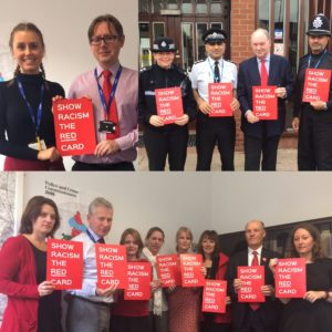 OPCC staff and police officers holding 'Show Racism the Red Car' banners