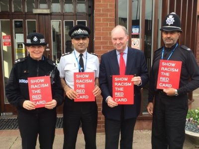 Warwickshire PCC Philip Seccombe with Police Officers holding Show Racism the Red Card placards