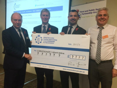 Warwickshire PCC Philip Seccombe launching the grant scheme at the 'Building a Stronger Warwickshire Together Conference' with,  from left, Councillor John Horner, Cabinet Portfolio Holder for Community Safety for Warwickshire County Council; Paul Tolley from Warwickshire Community and Voluntary Action; and Phil Evans,  Head of Community Services for Warwickshire County Council.