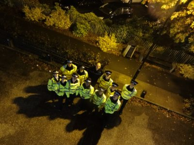 Police cadets look up at the camera