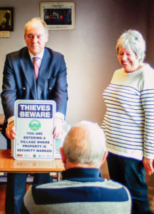 Philip showing off the new 'Thieves Beware' signs with Rachel Settle, Neighbourhood Watch co-ordinator for Willoughby.