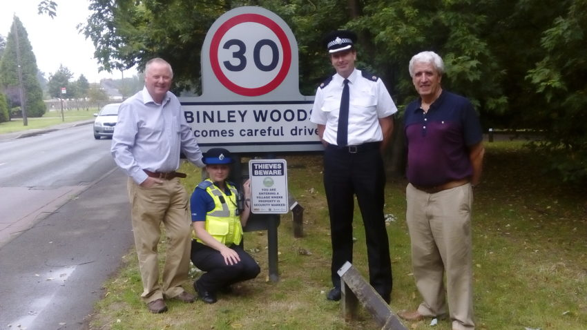The new signs being put up on the roads into Binley Woods. From left, Paul Salisbury, Chair of Binley Woods Parish Council, PCSO Charlie Cawte and Superintendent David Gardner from Warwickshire Police and Steve Roberts, Parish Councillor responsible for Community Alerts and Safety.