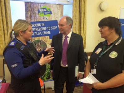 Warwickshire PCC Philip Seccombe talking to a PCSO and Carol Cotterill