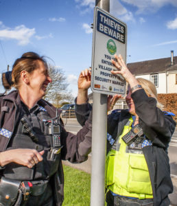 PC Paula Haden and PCSO Kamila Shilton from the Rugby Rural South SNT putting up the signs at the entrance to Willoughby