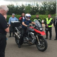 Riders watch on as the instructor talks through throttle control and correct gearing.