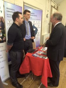 Philip talks with the Cyber Crime Advisors at the meeting.