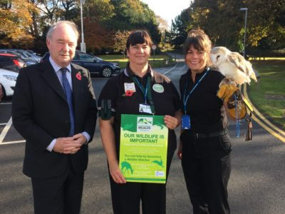 Philip Seccombe, Warwickshire Police and Crime Commissioner with Carol Cotterill, Chair of Warwickshire Rural Watch, and PC Lucy Whatmore from Bedworth Police Station holding one of the owls from the Nuneaton and Warwickshire Wildlife Sanctuary.