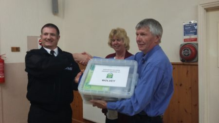 Handing over the Crime Prevention Toolbox.