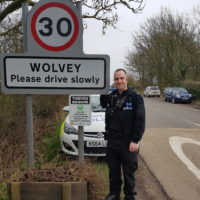 PC Stuart Baker from Warwickshire Police with the signage at the village entrance.