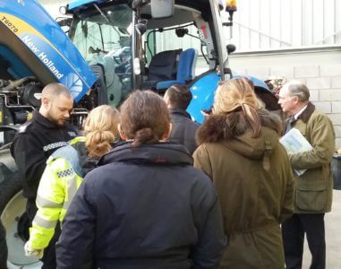 The PCC and officers examine agricultural machinery for vehicle identification markings.