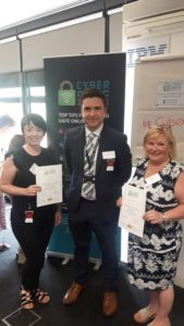 Cyber Crime Advisor Sam Slemensek presents Cyber Champions certificates to the delegates from the Family Intervention Counselling Service.