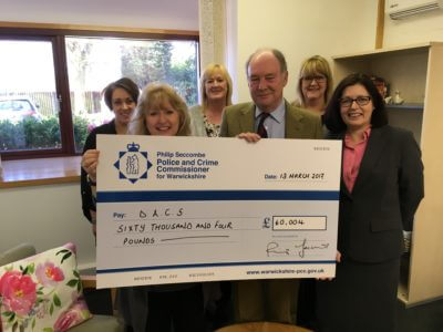 Presenting the cheque to staff at the Domestic Abuse Counselling Service in Bedworth.