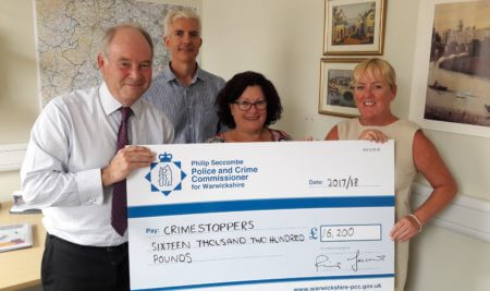 Warwickshire Police and Crime Commissioner hands over the funding to Crimestoppers representatives, from left, Warwickshire committee Vice Chair Rob Musgrove; Regional Manager Pauline Hadley and Senior Trust Manager Amanda Corcoran.