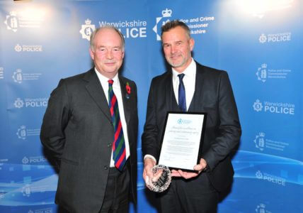 Warwickshire Police and Crime Commissioner handing the Award for Excellence in Policing and Community Safety to PC Martin Rone-Clarke.