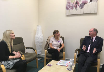 Warwickshire PCC Philip Seccombe (right) talks with RoSA Manager Julie Bettelley (left) and RoSA Board of Trustees Chair Sue Crosson (centre)