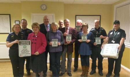 Brinklow Supported Villages Scheme launch, from left : PCSO Sharon Baille Crabtree, PCSO David Banks, Jennie Boonham, Deputy PCC Robt Tromans, Vera McBay, David Lowe, John Reid, Michael Lavin, Elaine Friswell and PC Stuart Baker.