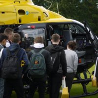 Academy students get up close with the helicopter and its controls