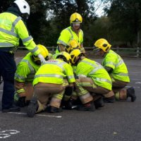 Fire and ambulance officers tend to a casualty during a mock road traffic collision demonstration.