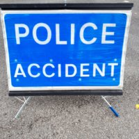 A Police Accident sign.