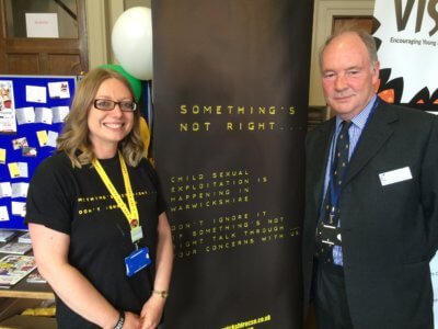 Katy Shipley from Barnardo's helping to promote the Something's Not Right campaign with Warwickshire PCC Philip Seccombe