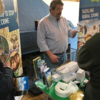 Design Out Crime Officer Mark English demonstrates a range of security devices suitable for agricultural premises at the farm event.
