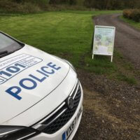 A police car at the entrance to the rural crime farm event.