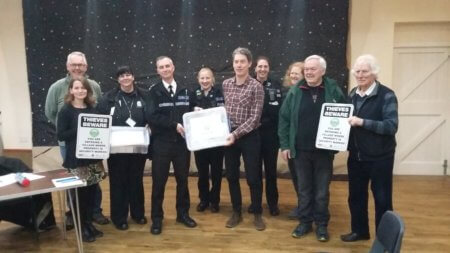 Chief Inspector Daf Goddard presenting the community box to Michael Koch, Chair of Marton Parish council with Carol Cotterill, Rural Crime Officer, PC Paula Haden, PCSO Kamilla Shilton from Rugby SNT and members of the Marton community.