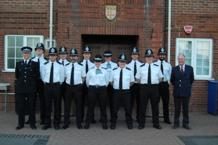 Assistant Chief Constable Alex Franklin Smith and Warwickshire Police and Crime Commissioner Philip Seccombe with the new police officers at their passing out ceremony at Warwick School
