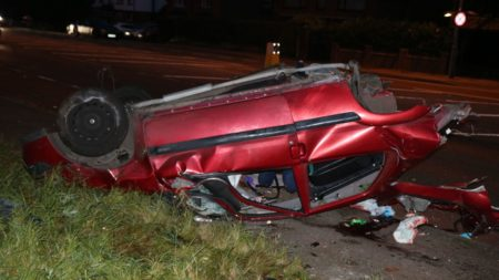 An overturned crashed car on the A5 near Atherstone