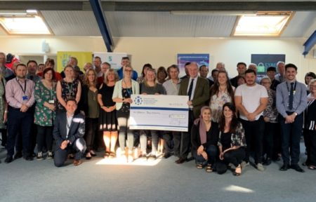 Grants recipients line up with PCC Philip Seccombe and a giant cheque