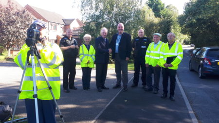 Pictured at Nether Whitacre is Community Speedwatch volunteer Carol Wallace (behind the speed camera), with, from left to right: PC Simon Ackroyd, Speedwatch co-ordinator Bev Woollaston, Police and Crime Commissioner Philip Seccombe, Cllr David Reilly, PC Simon Ackroyd and Community Speedwatch volunteers Arthur Harris and Steve Collins.