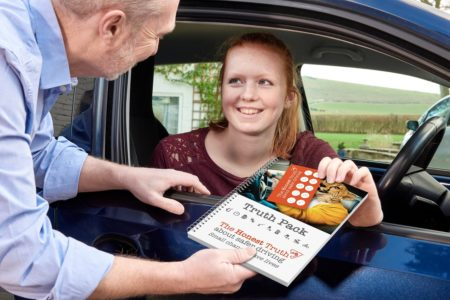 An ADI shows a learner driver the Honest Truth road safety pack
