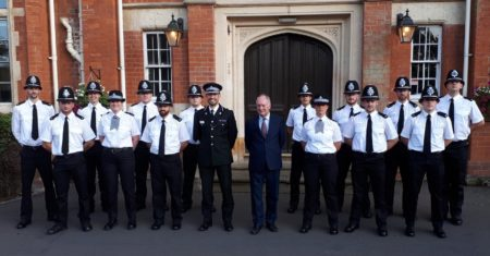PCC Philip Seccombe and Deputy Chief constable Richard Moore with new police officers at their passing out ceremony in Warwick in August.