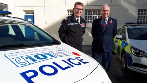 The poppy appeal logo on a police car bonnet