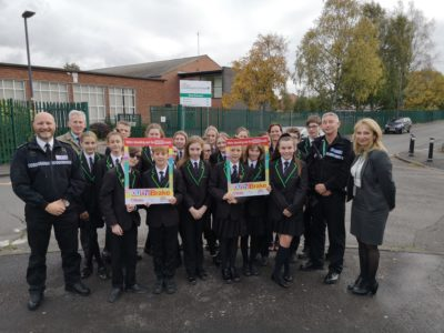 Students from The George Eliot School in Nuneaton help launch Youth for Brake – a new road safety and sustainable transport campaign in Warwickshire. They're joined by: (from left to right) Insp Jem Mountford from Warwickshire Police, Chris Lewis, Development and Policy Lead at Warwickshire Office of the Police and Crime Commissioner, Sophie Smith, head of PSHE at The George Eliot School, Fiona Fisher from Brake, PC Lee Marston from Warwickshire Police and headteacher Homeira Zakary.