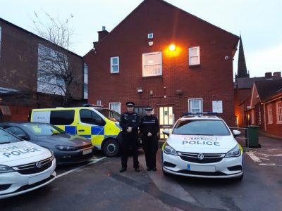 Patrol police officers with the police vehicles at Coleshill
