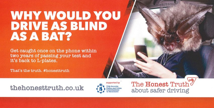The Honest Truth billboard advertisement, showing a car driver with a bat's head looking at a mobile phone, with the caption Why would you drive as blind as a bat?