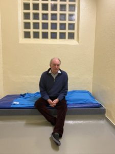 Philip Seccombe sitting in a cell at Leamington Police Station during his 'Night in Custody'