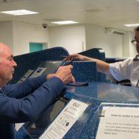 Sergeant Alan Edwards books Philip into Custody