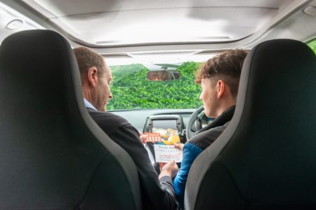 An Honest Truth Approved Driving Instructor shows road safety messages to a pupil during a lesson