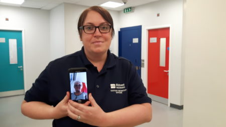 Bidvest Noonan detention officer Clare Harvey in Nuneaton custody with Independent Custody Visitor Sue Such pictured via video conference call on the mobile phone.
