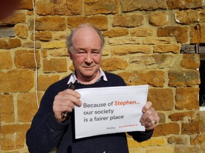Warwickshire Police and Crime Commissioner Philip Seccombe with a Stephen Lawrence Day banner
