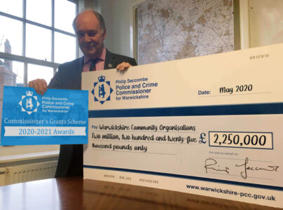 Philip Seccombe with a large cheque for the grants recipients