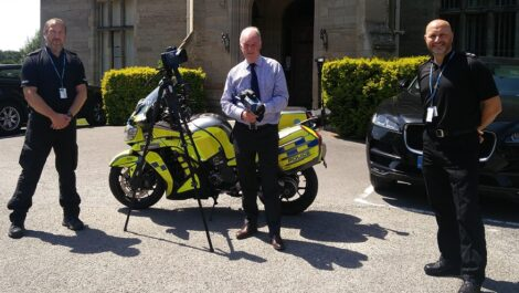 PCC Philip Seccombe (centre) shows off the new camera equipment with Sgt Shaun Bridle (left) and Inspector Jem Mountford from Warwickshire Police