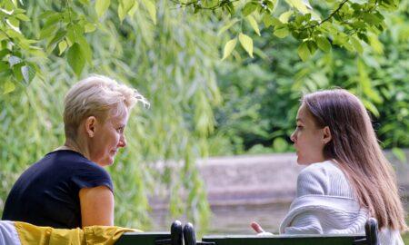 Two women sat talking