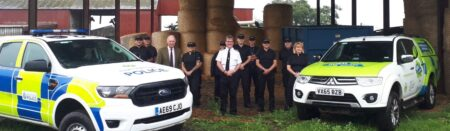 The PCC and Chief Constable pose on a farm with the expanded rural crime team