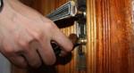 A hand trying a door handle