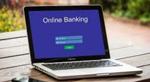 A laptop computer showing a banking website login
