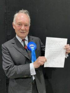 Philip Seccombe holding the signed Oath of Office